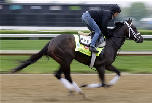 Exercise rider Nick Bush CHARMING KITTEN at Churchill Downs Monday, April 29, 2013, in Louisville, Ky. (AP Photo/Morry Gash)