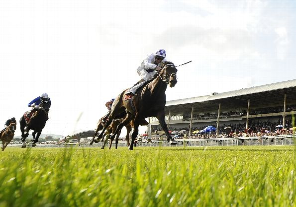 Kevin Manning riding Trading Leather win The Dubai Duty Free Irish Derby at Curragh racecourse on June 29, 2013 in Kildare, Ireland. (Photo by Alan Crowhurst/Getty Images)