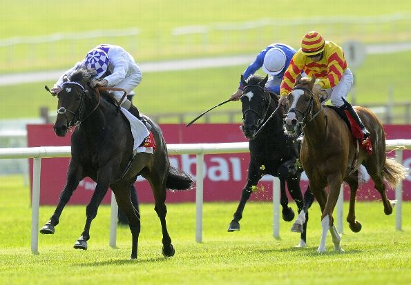 Kevin Manning riding Trading Leather (L) win The Dubai Duty Free Irish Derby at Curragh racecourse on June 29, 2013 in Kildare, Ireland. (Photo by Alan Crowhurst/Getty Images)