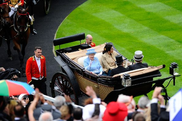Racegoers wave at Queen Elizabeth II, Prince El Hassan Bin Talal, Princess Sarvath El Hassan and John Warren as they arrive with the Royal Procession on day five of Royal Ascot at Ascot Racecourse on June 22, 2013 in Ascot, England. (Photo by Alan Crowhurst/Getty Images for Ascot Racecourse)