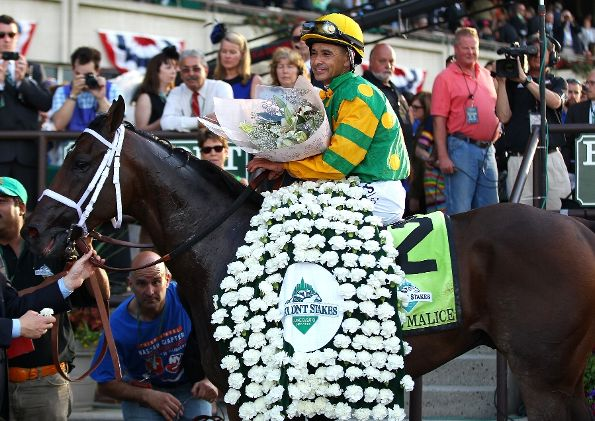 Jockey Mike Smith sits aboard Palace Malice in the winners circle after winning the 145th running of the Belmont Stakes at Belmont Park on June 8, 2013 in Elmont, New York. (Photo by Mike Stobe/Getty Images)